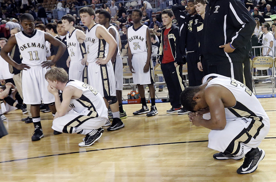 Okemah reacts to the loss to Millwood during the state high school basketball tournament Class 3A boys championship game between Millwood High School and Okemah High School at the State Fair Arena on Saturday, March 9, 2013, in Oklahoma City, Okla. Photo by Chris Landsberger, The Oklahoman
