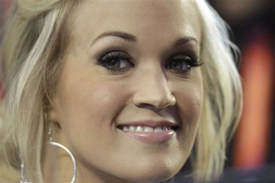 Carrie Underwood takes the stage to perform the National Anthem before the start of the NFL Super Bowl XLIV football game in Miami. Underwood can make history as the first woman to win two entertainer of the year awards when the stars turn out at the MGM Grand on Sunday, April 18, 2010 in Las Vegas. AP Photo
