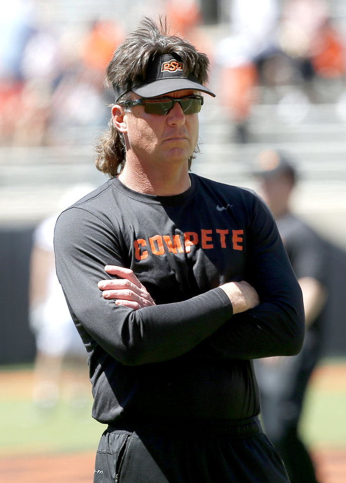 Photo - Oklahoma State head coach Mike Gundy watches drills during the Oklahoma State Cowboys spring practice at Boone Pickens Stadium in Stillwater, Okla., Saturday, April 20, 2019.  Photo by Sarah Phipps, The Oklahoman