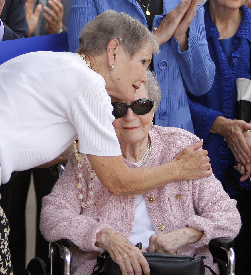 OPEN / OPENING: Patience S. Latting receives a hug from former employee Fran Cory during the opening of the new Patience S. Latting Northwest Library in Oklahoma City, Tuesday, May 22, 2012. Photo by Bryan Terry, The Oklahoman