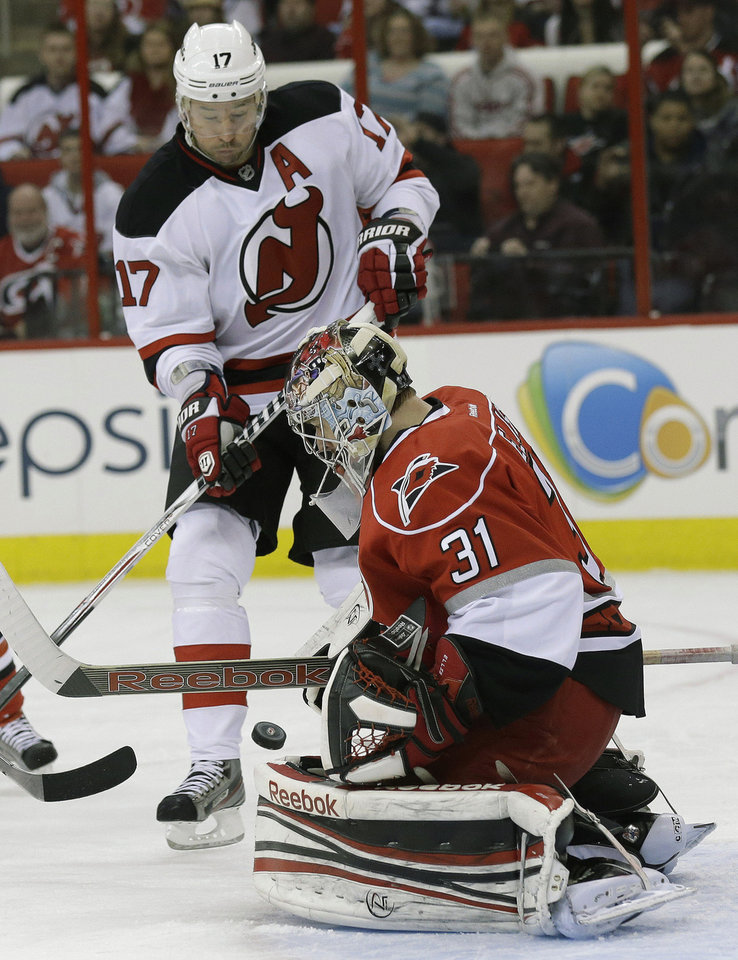 Carolina Hurricanes goalie Dan Ellis (31) defends the goal against New Jersey Devils' Ilya Kovalchuk (17), of Russia, during the first period of an NHL hockey game in Raleigh, N.C., Thursday, March 21, 2013. (AP Photo/Gerry Broome)