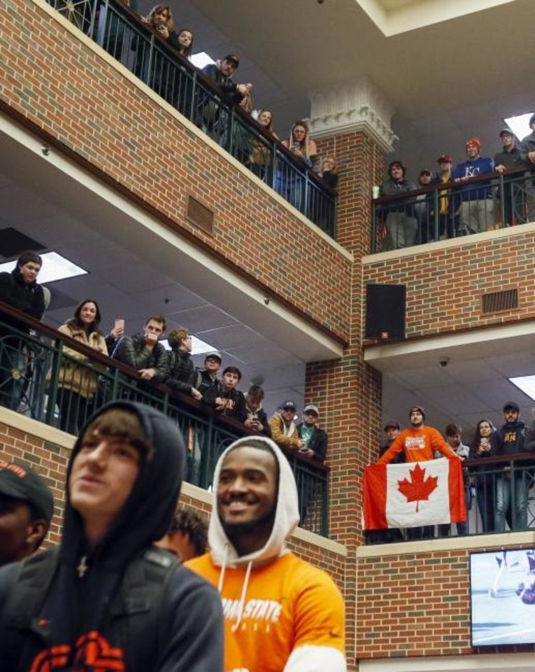 Photo -  Oklahoma State students and fans watch from the upper floors of the OSU Student Union during a football pep rally Tuesday. [Nate Billings/The Oklahoman]