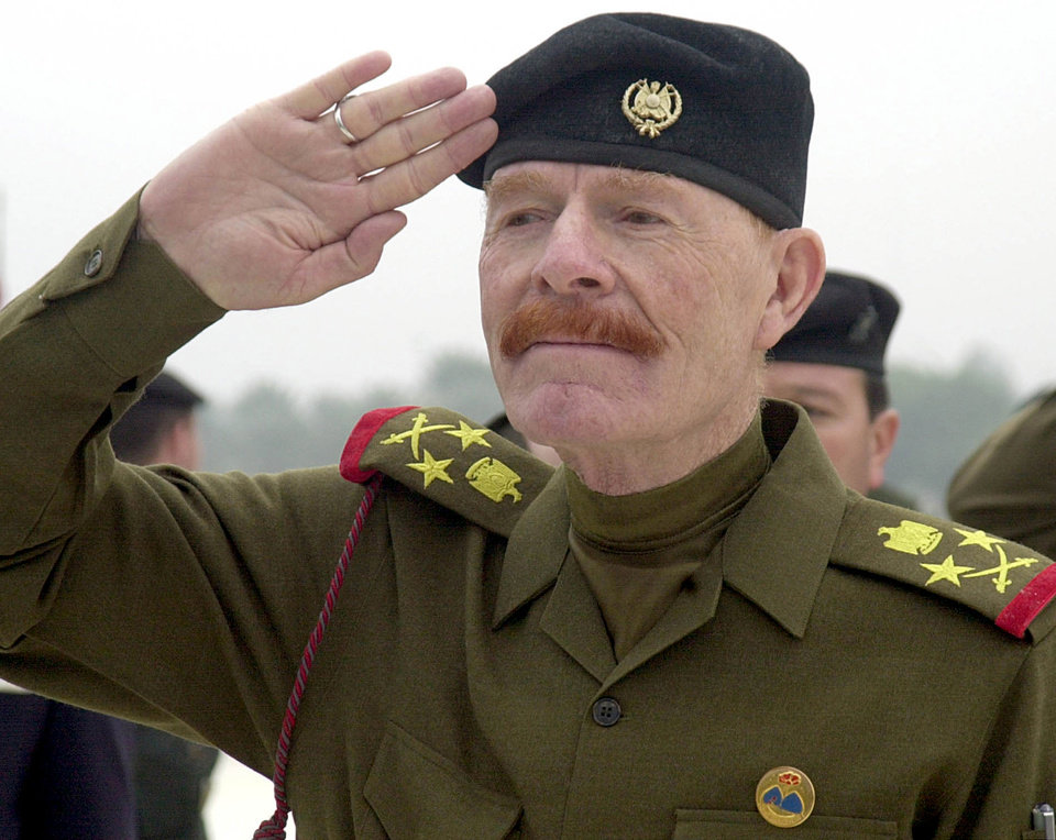Photo - FILE - in this Sunday, Dec. 1, 2002 file photo, Iraqi Vice chairman of the Revolutionary Command Council, Izzat Ibrahim al-Douri salutes during a ceremony at the huge Martyrs Monument in Baghdad, Iraq,  A shadowy militant group linked to the highest-ranking member of Saddam Hussein's regime still at large could be among the beneficiaries of the unrest that erupted this week in Iraq and is posing perhaps the gravest challenge for Iraq's stability since U.S. troops left.(AP Photo/Jassim Mohammed, File)
