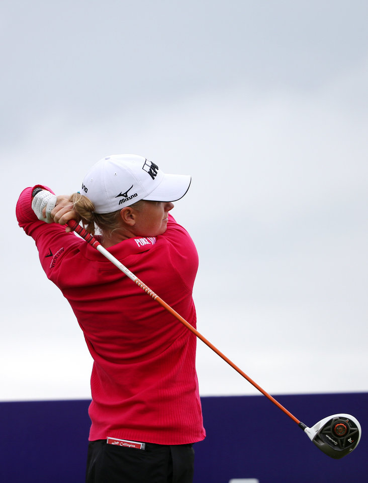 Stacy Lewis of the US, tees off on the second hole during the first round of the Women's British Open golf championship on the Old Course at St Andrews, Scotland, Thursday Aug. 1, 2013. (AP Photo/Scott Heppell)