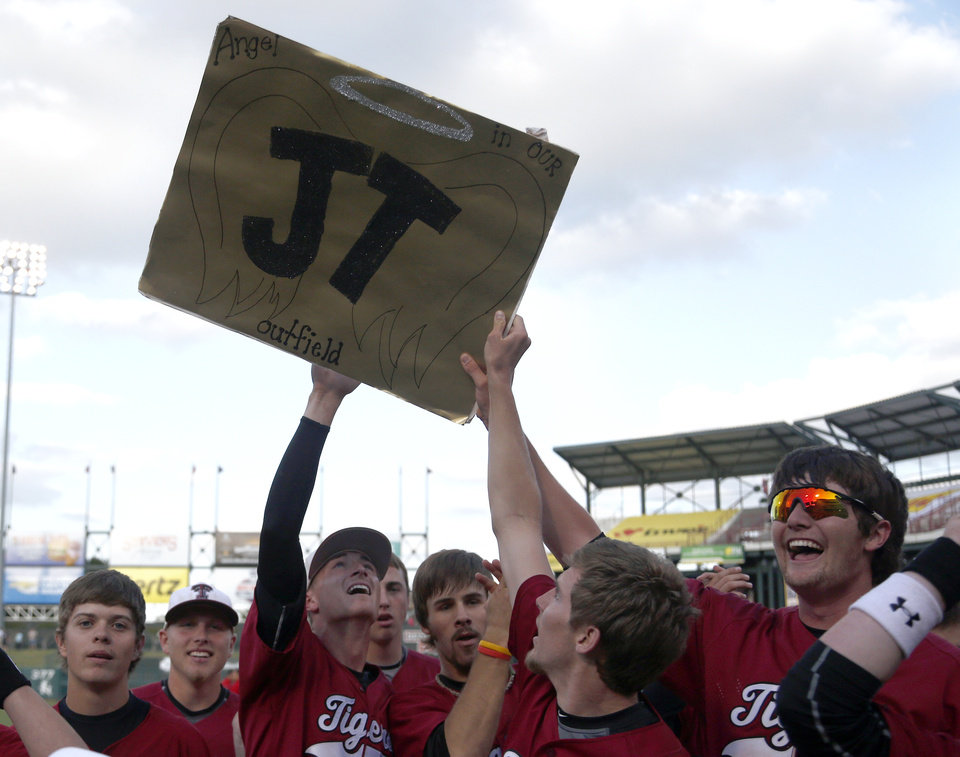 Photo - Tuttle holds up a sign for their teammate that died seven years ago following the class 4A state baseball championship game between Tuttle and Dewey at the Chickasaw Bricktown Ballpark in Oklahoma City, Saturday, May 17, 2014. Photo by Sarah Phipps, The Oklahoman