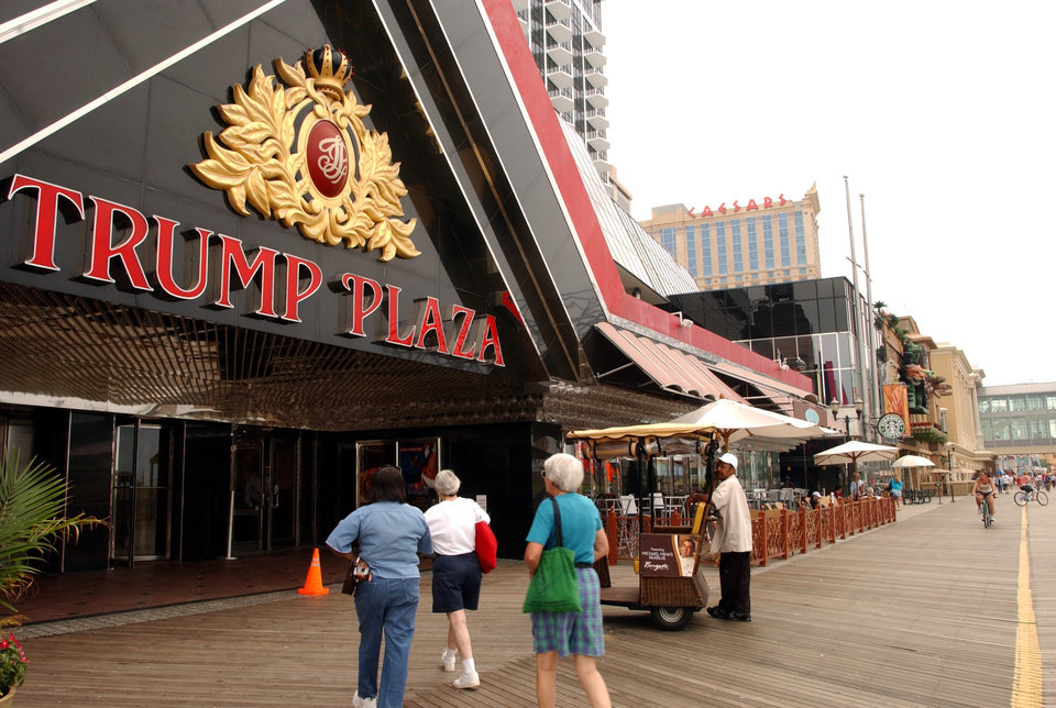 Photo - FILE - In this July 8, 2006 file photo, pedestrians enter the Trump Plaza in Atlantic City, N.J. The rapid disintegration of Atlantic City's casino market might be an early indicator of what could happen in other parts of the country that have too many casinos and not enough gamblers.  (AP Photo/Mary Godleski, File)