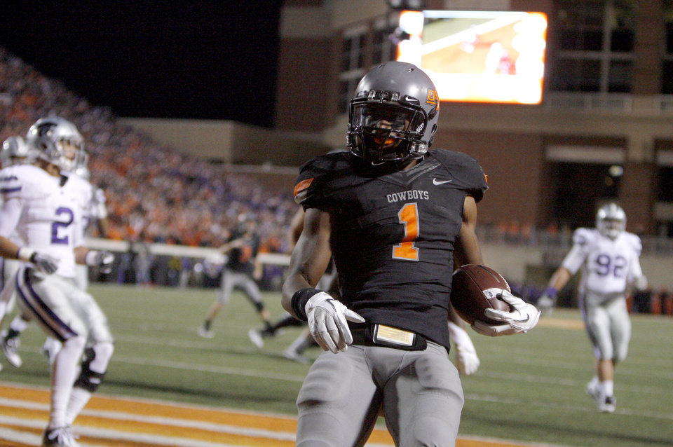 Photo - Oklahoma State's Joseph Randle (1)celebrates a touchdown during a college football game between the Oklahoma State University Cowboys (OSU) and the Kansas State University Wildcats (KSU) at Boone Pickens Stadium in Stillwater, Okla., Saturday, Nov. 5, 2011.  Photo by Sarah Phipps, The Oklahoman
