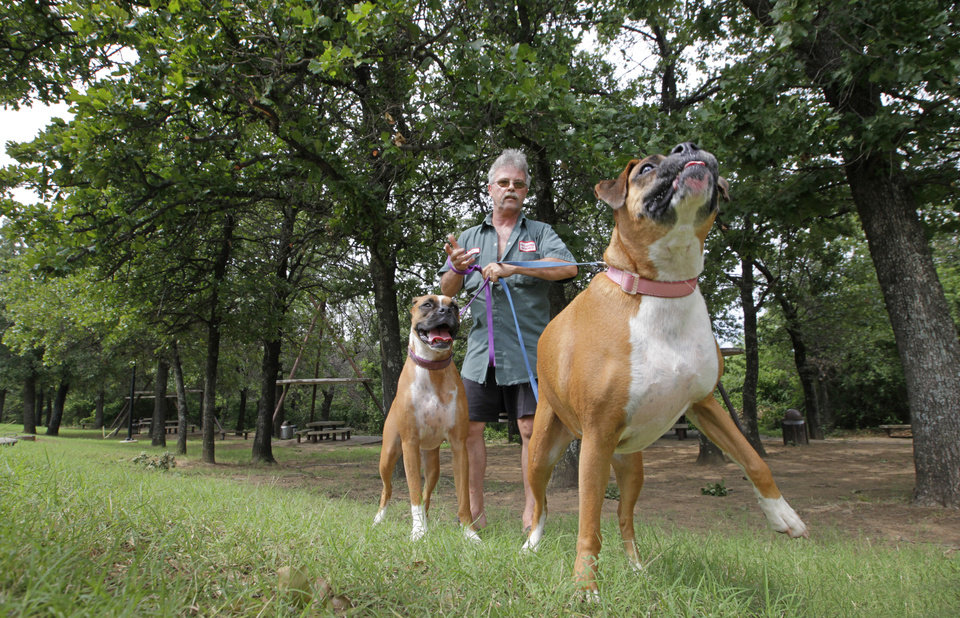 Mike Mitchell, of Oklahoma City, exercises his dogs, Cloe and Darlathe, at a rest stop off I-35 south of Pauls Valley. PHOTO BY DAVID MCDANIEL, THE OKLAHOMAN <strong>David McDaniel - The Oklahoman</strong>