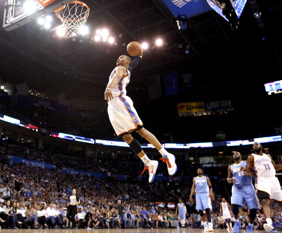 Oklahoma City\'s Russell Westbrook (0) dunks during the NBA basketball game between the Oklahoma City Thunder and the Denver Nuggets, Friday, April 8, 2011, at the Oklahoma City Arena.. Photo by Sarah Phipps, The Oklahoman ORG XMIT: KOD