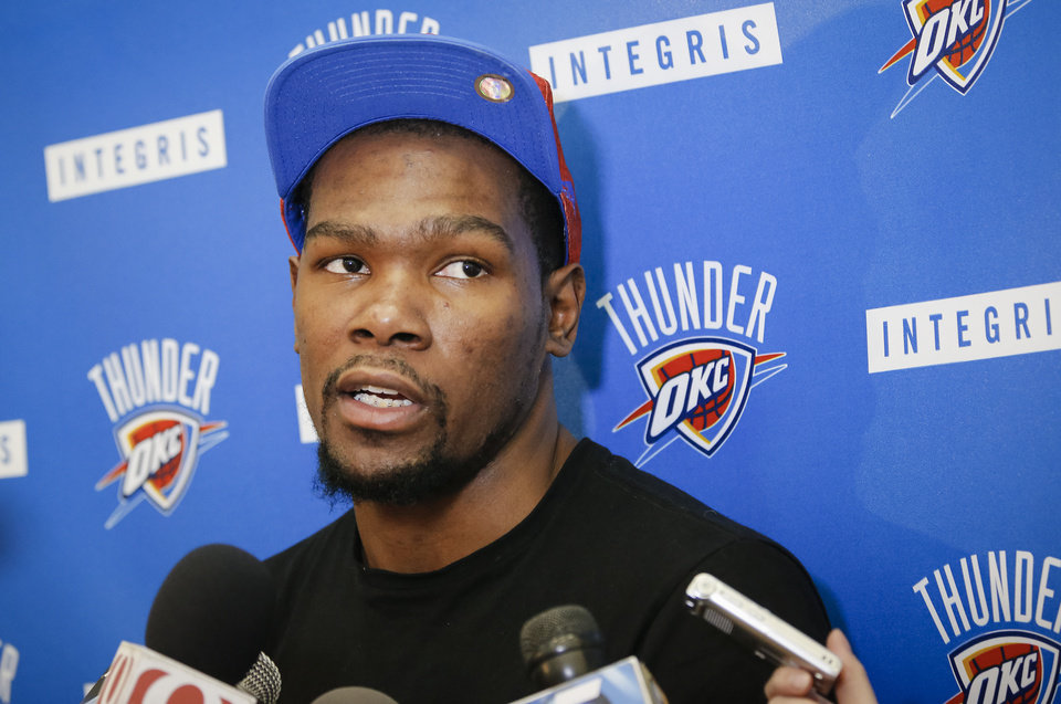 Photo - Kevin Durant speaks during the Oklahoma City Thunder media availability at the Thunder practice facility in Oklahoma City, Okla. on Monday, May 12, 2014.   Photo by Chris Landsberger, The Oklahoman