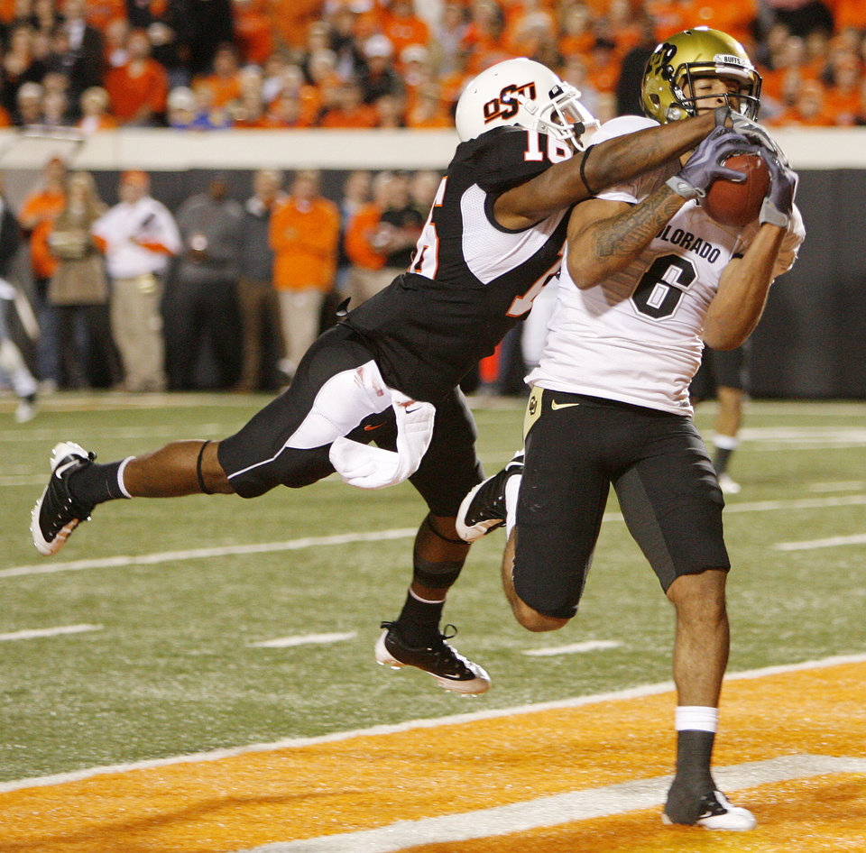 Colorado's Markques Simas (6) makes a toucdown catch as Perrish Cox (16) of OSU defends in the third quarter during the college football game between Oklahoma State University (OSU) and the University of Colorado (CU) at Boone Pickens Stadium in Stillwater, Okla., Thursday, Nov. 19, 2009. OSU won, 31-28. Photo by Nate Billings, The Oklahoman