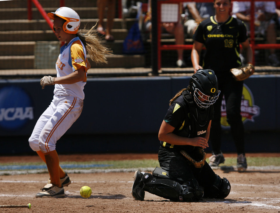 Tennessee's Ashley Andrews (22) runs in to home past Oregon's Alexa Peterson (14) during a Women's College World Series game between Tennessee and Oregon at ASA Hall of Fame Stadium in Oklahoma City,Saturday, June 2, 2012.  Photo by Garett Fisbeck, The Oklahoman