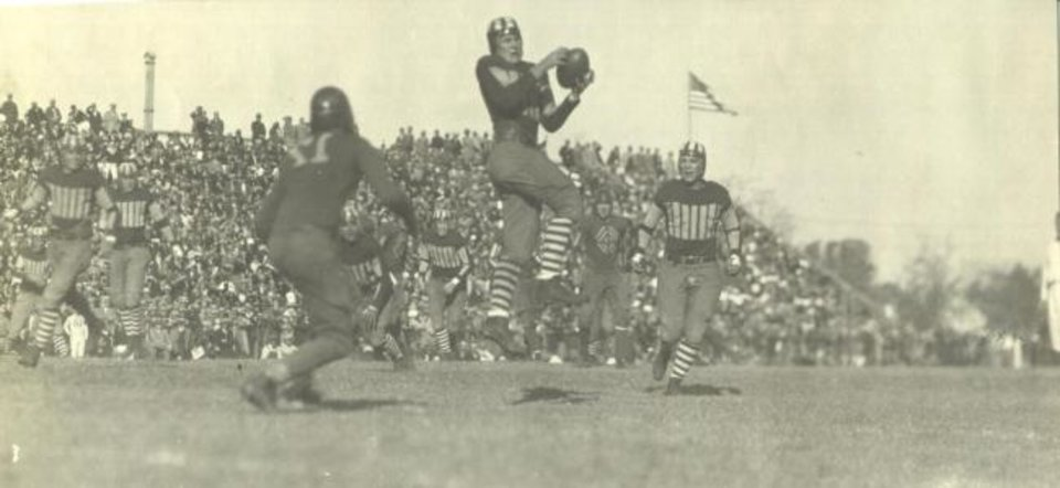Photo -  Back in the era of leather helmets, Oklahoma handed Kansas a 26-7 loss on Nov. 19, 1927, in Norman. [OKLAHOMAN ARCHIVES]