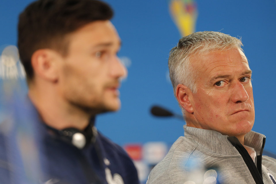 Photo - France's Hugo Lloris, left, and head coach Didier Deschamps, right, attend a press conference at the Estadio Beira-Rio in Porto Alegre, Brazil, Saturday, June 14, 2014. France will play in group E of the World Cup. (AP Photo/David Vincent)
