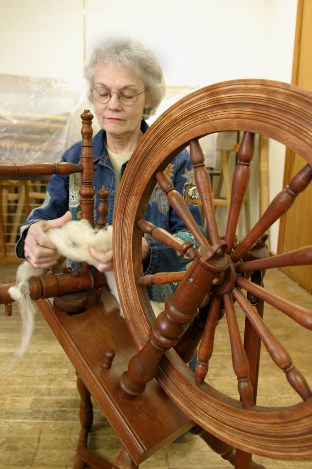 """Instructor Wanda Nobbe at the spinning wheel.  """"Hair"""" is spun into yarn for weaving project.<br/><b>Community Photo By:</b> Bob Bozarth<br/><b>Submitted By:</b> Sue, Guthrie"""