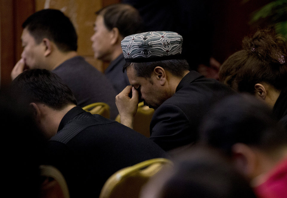 Photo - Relatives of Chinese passengers aboard the missing Malaysia Airlines flight MH370 react during a briefing held by Malaysia officials at a hotel in Beijing, China Friday, April 11, 2014. Authorities are confident that signals detected deep in the Indian Ocean are from the missing Malaysian jet's black boxes, Australia's Prime Minister Tony Abbott said Friday, raising hopes they are near solving one of aviation's most perplexing mysteries. (AP Photo/Andy Wong)