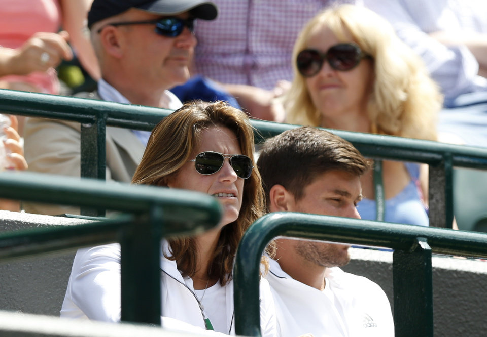 Photo - Coach of Andy Murray Amelie Mauresmo, front left, watches the men's singles match between Andy Murray of Britain and Biaz Rola of Slovenia at the All England Lawn Tennis Championships in Wimbledon, London Wednesday, June 25, 2014. (AP Photo/Sang Tan)