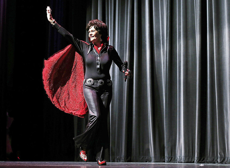 Photo - Dawn Anita Plumlee of Duncan waves to the crowd after performing as Lady Elvis  during the talent portion of the Ms. Oklahoma Senior America Pageant. Photo by Bryan Terry, The Oklahoman  Bryan Terry - THE OKLAHOMAN