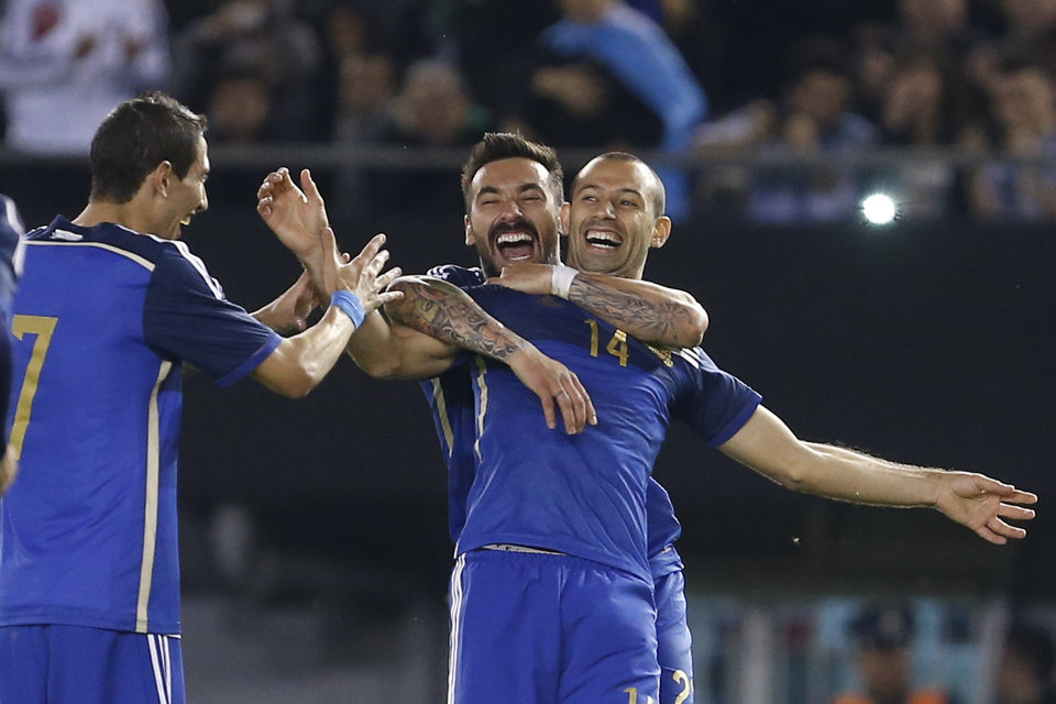 Photo - Argentina players Angel Di Maria, left, Ezequiel Lavezzi, center, celebrate Javier Mascherano's goal, right, against Trinidad and Tobago during an international friendly soccer match in Buenos Aires, Argentina, Wednesday, June 4, 2014. (AP Photo/Victor R. Caivano)