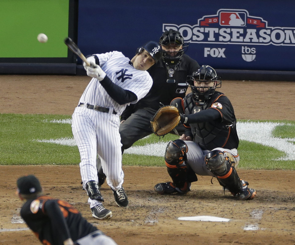 Photo -   New York Yankees' Mark Teixeira hits a single against Baltimore Orioles pitcher Jason Hammel during the fifth inning in Game 5 of the American League division baseball series on Friday, Oct. 12, 2012, in New York. Orioles' catcher Matt Wieters and home plate umpire Mike Everitt watch the hit. (AP Photo/Peter Morgan)