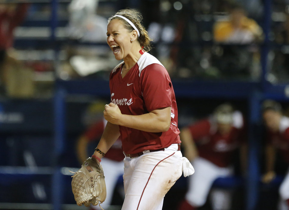 Photo - Oklahoma's Keilani Rickets celebrates the Sooner's win over Washington during Women's College World Series softball game at ASA Hall of Fame Stadium in Oklahoma City, Sunday, June, 2, 2013. Photo by Sarah Phipps, The Oklahoman