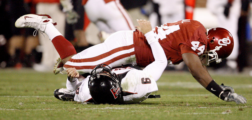 OU's Jeremy Beal falls onto Graham Herrel of Texas Tech after a play during the college football game between the University of Oklahoma Sooners and Texas Tech University at Gaylord Family -- Oklahoma Memorial Stadium in Norman, Okla., Saturday, Nov. 22, 2008. BY BRYAN TERRY, THE OKLAHOMAN