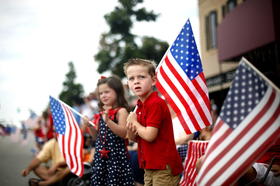 Photo - Caden Lackey, 5, watches the LibertyFest Parade in Edmond, Okla., Monday, July 4, 2011. Photo by Sarah Phipps, The Oklahoman