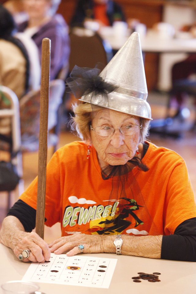 Belva Hayes, dressed as the Tin Man, plays trick-or-treat bingo at the Edmond Senior Center.