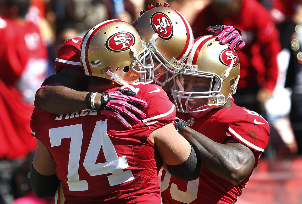 San Francisco 49ers wide receiver Kyle Williams, center, celebrates with offensive tackle Joe Staley (74) and tight end Vernon Davis after scoring on a touchdown pass from quarterback Alex Smith during the second quarter of an NFL football game against the Buffalo Bills, Sunday, Oct. 7, 2012, in San Francisco. (AP Photo/Tony Avelar)
