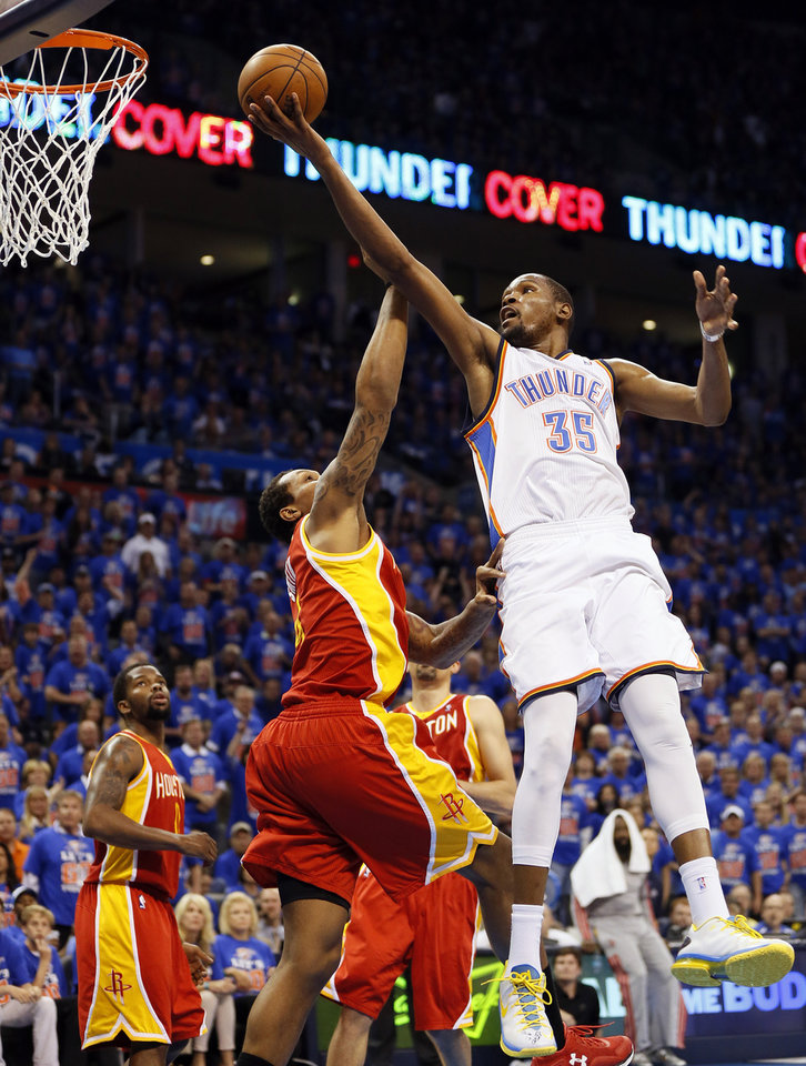 Oklahoma City\'s Kevin Durant (35) lays up a shot as he is fouled by Houston\'s Greg Smith (4) in the fourth quarter during Game 5 in the first round of the NBA playoffs between the Oklahoma City Thunder and the Houston Rockets at Chesapeake Energy Arena in Oklahoma City, Wednesday, May 1, 2013. Houston won, 107-100. Photo by Nate Billings, The Oklahoman
