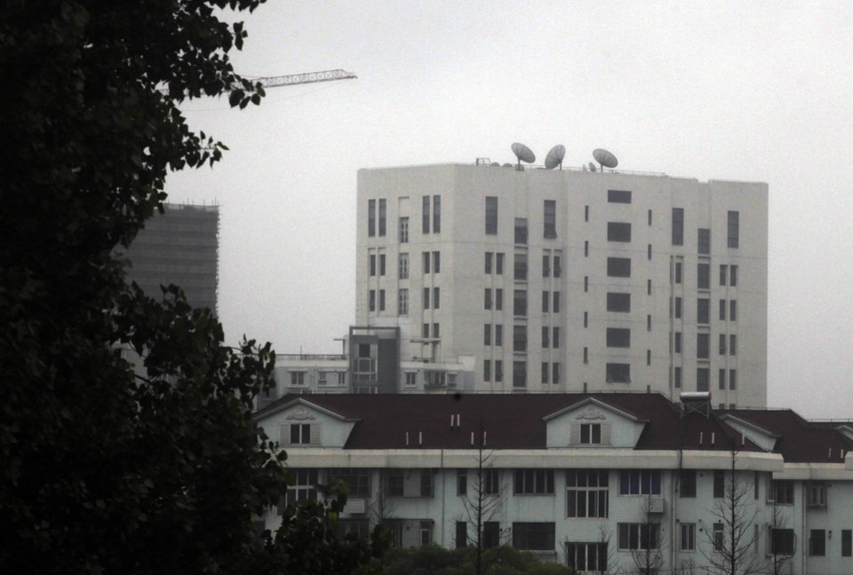 "Photo - FILE - This May 31, 2013 file photo shows the building housing ""Unit 61398"" of the People's Liberation Army, center top, on the outskirts of Shanghai, China. A U.S. security firm, Mandiant, said last year it traced attacks on American and other companies to the military unit in Shanghai.  China on Tuesday, May 20, 2004, warned the United States was jeopardizing military ties by charging five Chinese officers with cyberspying and tried to turn the tables on Washington by calling it"