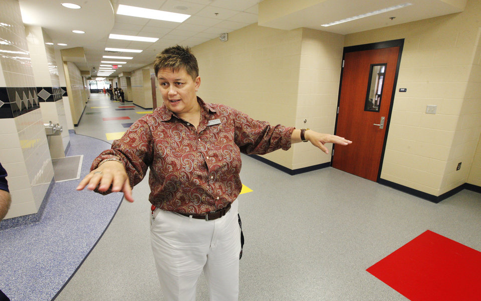 Photo -  Arbor Grove Elementary School Principal Brenda Davis talks about features in the newest school in the Putnam City School District. Photo by Paul B. Southerland, The Oklahoman   PAUL B. SOUTHERLAND -