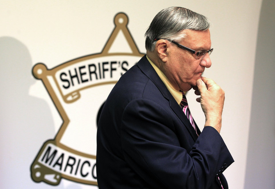 Photo - In this Tuesday, April 3, 2012 file photo, Maricopa County Sheriff Joe Arpaio pauses prior to holding a news conference after federal authorities announced that the sheriff has negotiated in bad faith and risks ending settlement talks, in Phoenix. (AP Photo/Ross D. Franklin, file)