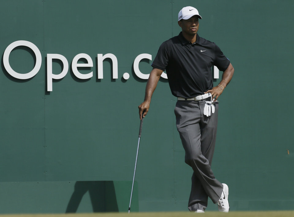Photo - Tiger Woods of the United States waits to play off the first tee during the third round of the British Open Golf Championship at Muirfield, Scotland, Saturday July 20, 2013. (AP Photo/Jon Super)