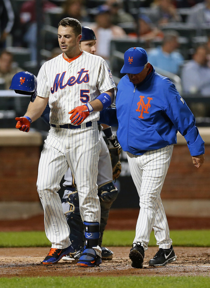 Photo - New York Mets David Wright (5) is escorted off the field by New York Mets manager Terry Collins after Wright was hit by a pitch in the third inning of a baseball game against the Milwaukee Brewers at Citi Field in New York, Thursday, Sept. 26, 2013. (AP Photo/Paul J. Bereswill)
