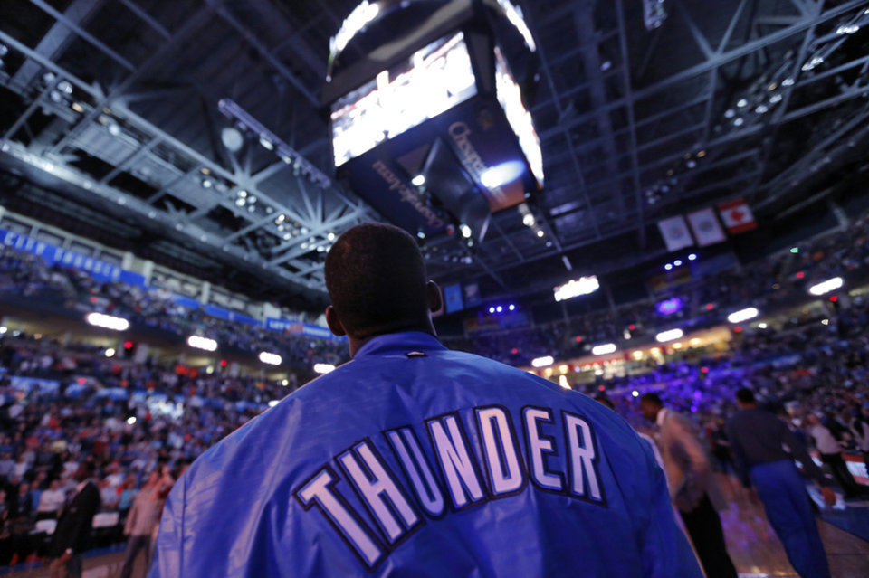 DeAndre Liggins watches the video board during the season finally NBA basketball game between the Oklahoma City Thunder and the Milwaukee Bucks at Chesapeake Energy Arena on Wednesday, April 17, 2013, in Oklahoma City, Okla.   Photo by Chris Landsberger, The Oklahoman