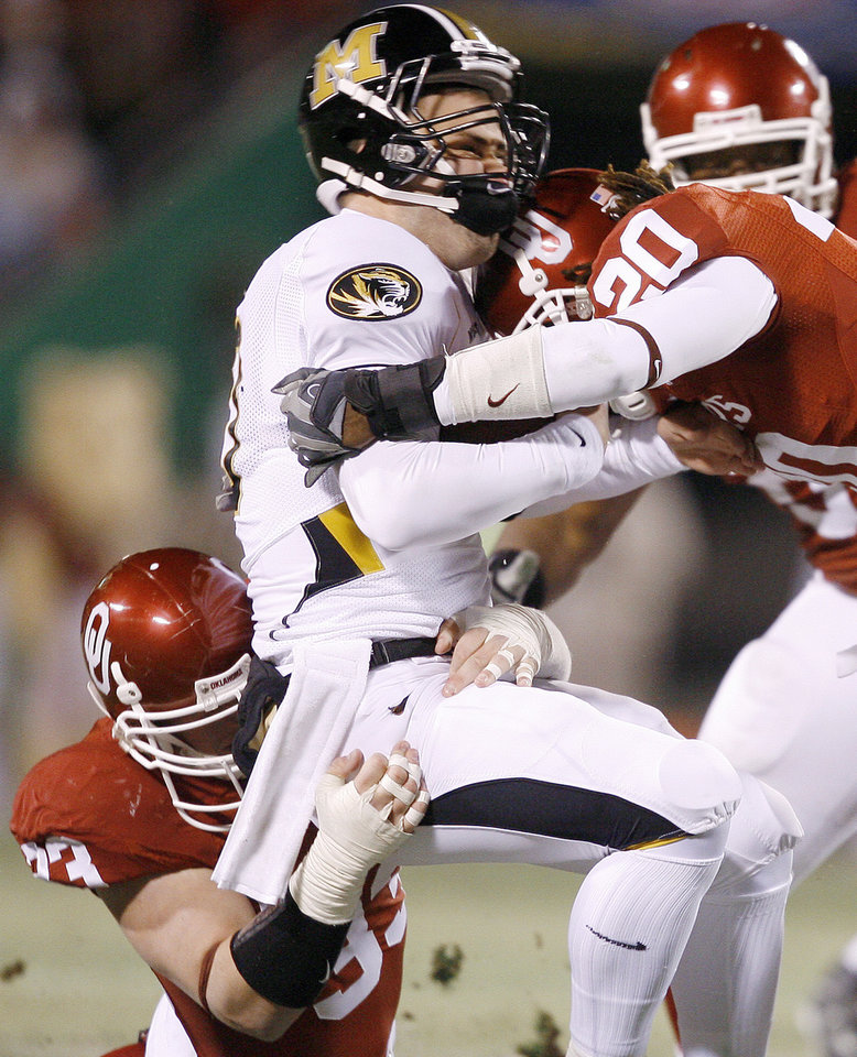 Photo - OU's Auston English, left, Quinton Carter take down Chase Daniel of Missouri during the first half of the Big 12 Championship college football game between the University of Oklahoma Sooners (OU) and the University of Missouri Tigers (MU) on Saturday, Dec. 6, 2008, at Arrowhead Stadium in Kansas City, Mo. 
