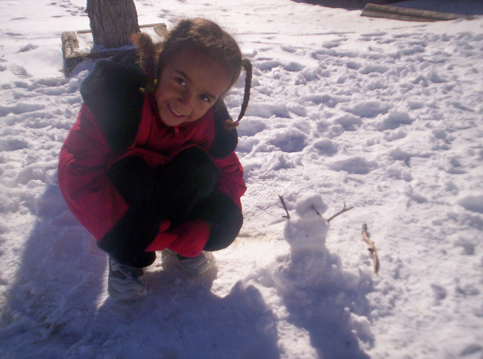 Kayla with her baby snowman<br/><b>Community Photo By:</b> Leah<br/><b>Submitted By:</b> Leah, Midwest City