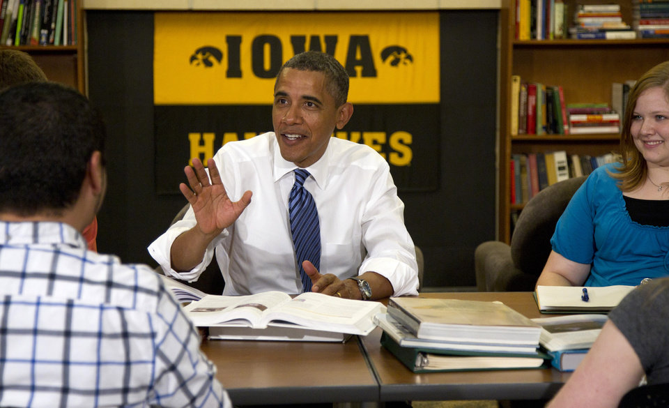 Photo -   President Barack Obama participates in a roundtable discussion with students at the University of Iowa, Wednesday, April 25, 2012, in Iowa City, Iowa. at right is Myranda Burnett, and left is Martin Lopez. (AP Photo/Carolyn Kaster)