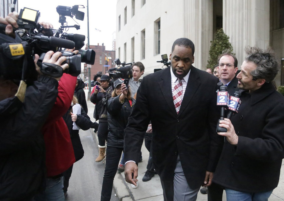 Photo - Former Detroit Mayor Kwame Kilpatrick leaves federal court after being convicted Monday, March 11, 2013, in Detroit, of corruption charges, ensuring a return to prison for a man once among the nation's youngest big-city leaders. (AP Photo/Detroit Free Press, Ryan Garza)