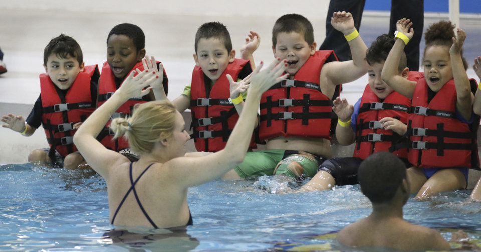 Photo -  YMCA swim instructor Bonnie Booth teaches water safety to kindergarten students from Mark Twain Elementary. Photo By Steve Gooch, The Oklahoman   Steve Gooch -
