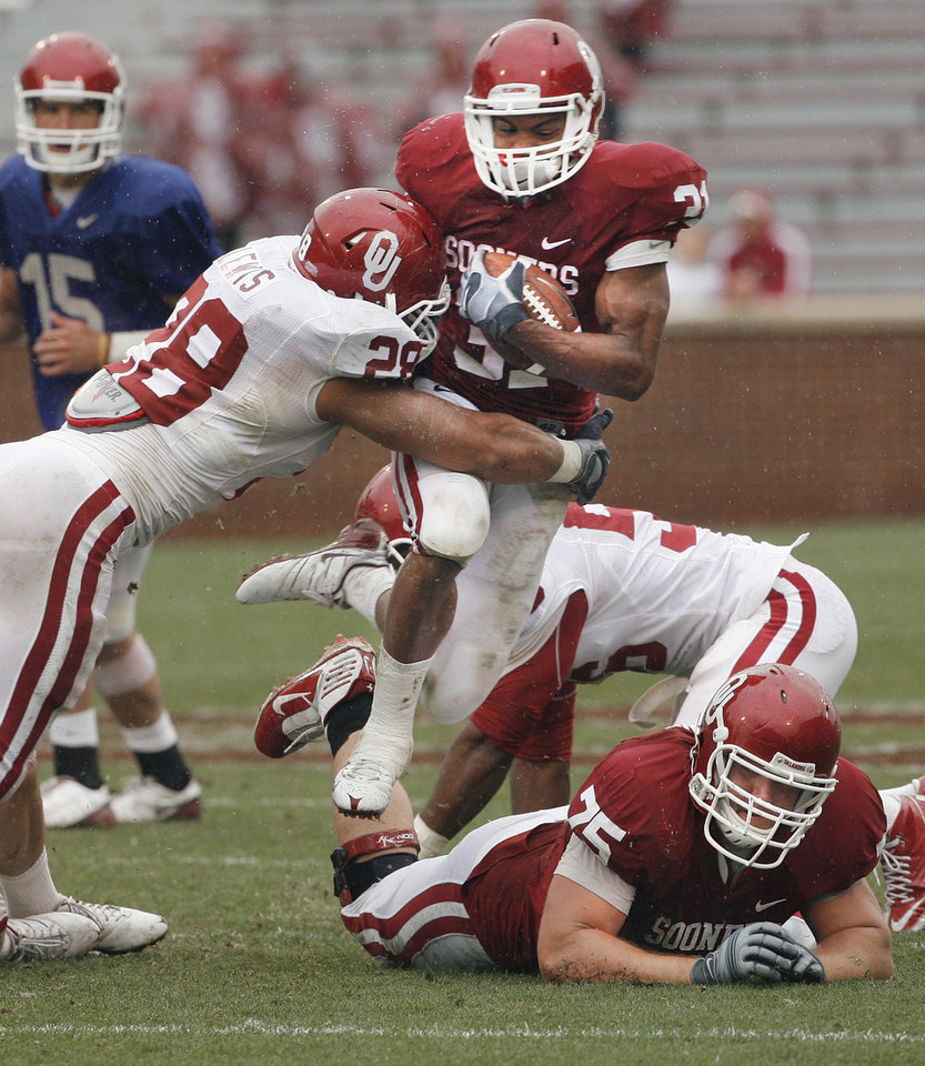 Photo - Daniel Franklin (31) is tackled by Travis Lewis (28) during the spring Red and White football game for the University of Oklahoma (OU) Sooners at Gaylord Family/Oklahoma Memorial Stadium on Saturday, April 17, 2010, in Norman, Okla.  Photo by Steve Sisney, The Oklahoman