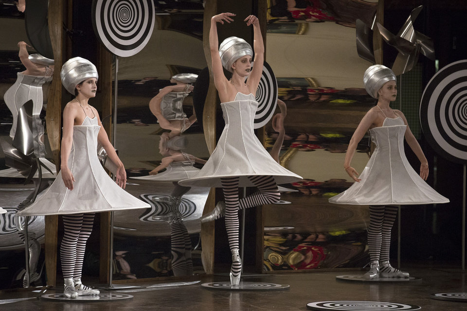 Photo -   Dancers perform in the background of the presentation space moments before the Thom Browne Spring 2013 collection is modeled during Fashion Week in New York, Monday, Sept. 10, 2012. (AP Photo/John Minchillo)