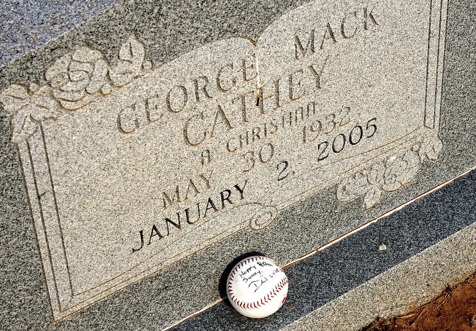 Photo - The ball left at George Cathey's grave side reads: