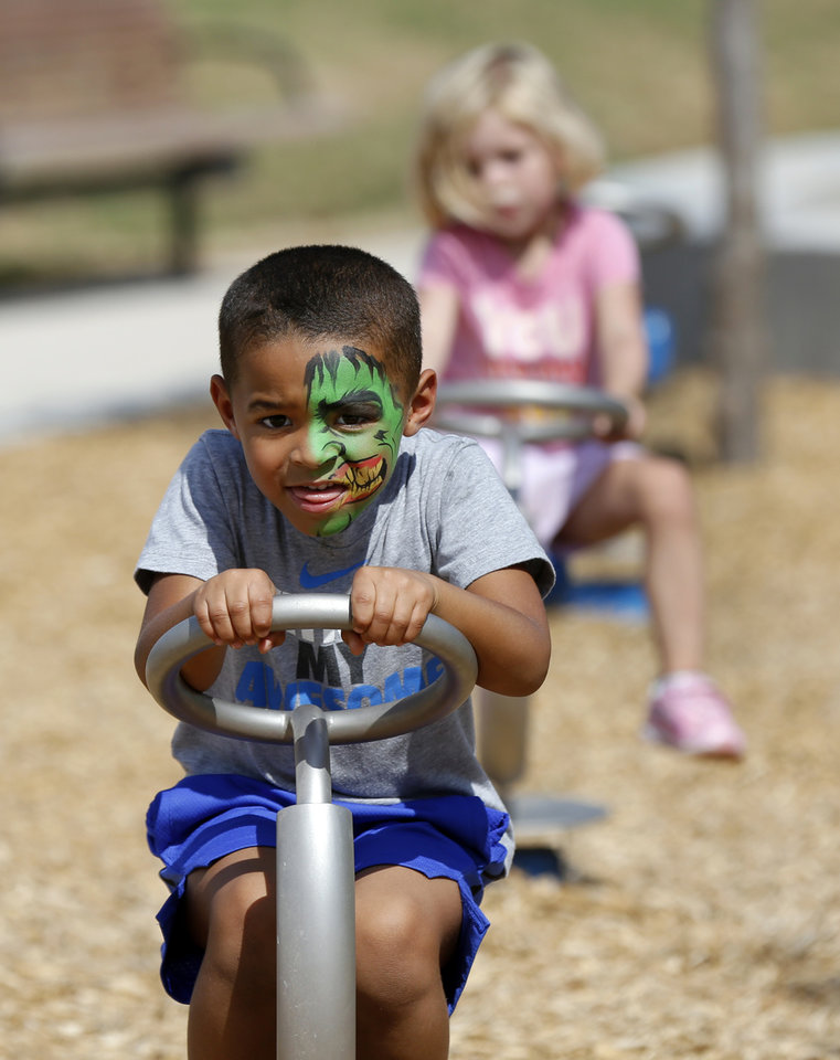 Photo - Cason Young, 4, plays in the children's playground during the grand opening weekend of Scissortail Park in Oklahoma City, Saturday, Sept. 28, 2019. [Nate Billings/The Oklahoman]
