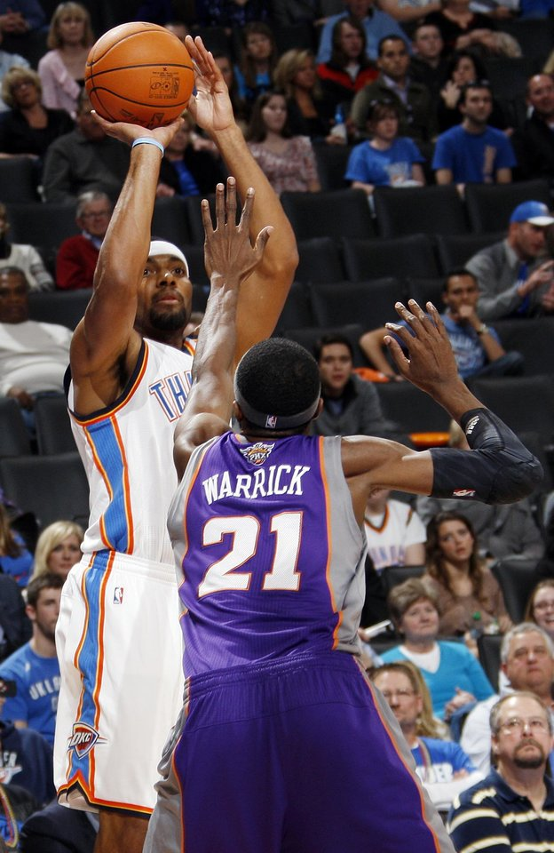 Photo - Oklahoma City's Lazar Hayward (11) shoots over Hakim Warrick (21) of Phoenix in the fourth quarter during the NBA basketball game between the Oklahoma City Thunder and Phoenix Suns at Chesapeake Energy Arena in Oklahoma City, Saturday, Dec. 31, 2011. Oklahoma City won, 107-97. Photo by Nate Billings, The Oklahoman