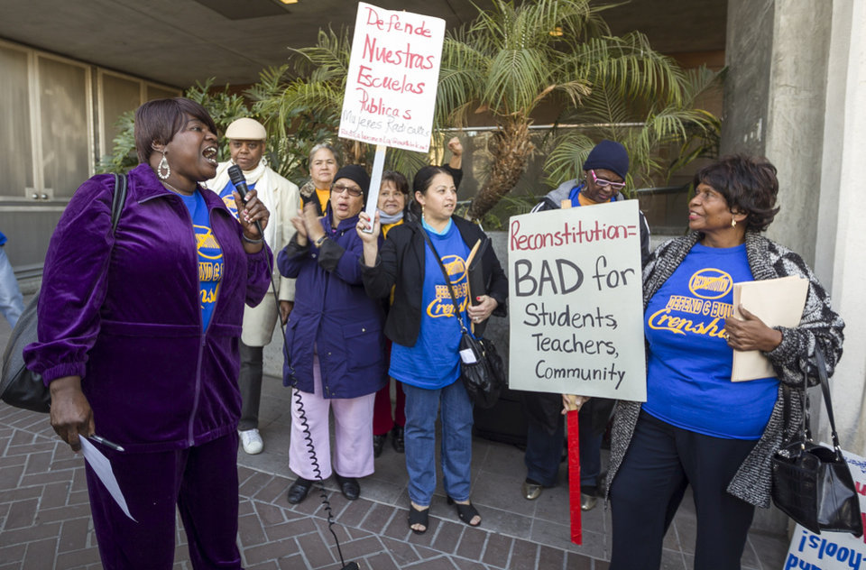 Photo - In this photo taken Tuesday, Jan. 15, 2013, parents, teachers and students of Crenshaw High School protest outside the Los Angeles Unified School District headquarters to try to stop the conversion of the school to a magnet program in Los Angeles Tuesday, Jan. 15, 2013. A backlash against drastic school reforms is growing across the nation. (AP Photo/Damian Dovarganes)