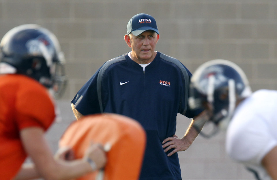 FILE - In this Sept. 15, 2010 file photo, University of Texas at San Antonio college football head coach Larry Coker watches a drill before UTSA'S first-ever scrimmage.  (AP Photo/San Antonio Express-News, Kin Man Hui) NO SALES ORG XMIT: TXSAE102