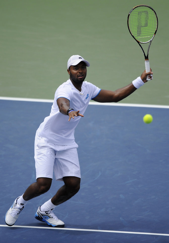 Photo - Donald Young gets set to returns a ball against Milos Raonic, of Canada, during a match at the Citi Open tennis tournament, Saturday, Aug. 2, 2014, in Washington. Raonic won 6-4, 7-5. (AP Photo/Nick Wass)