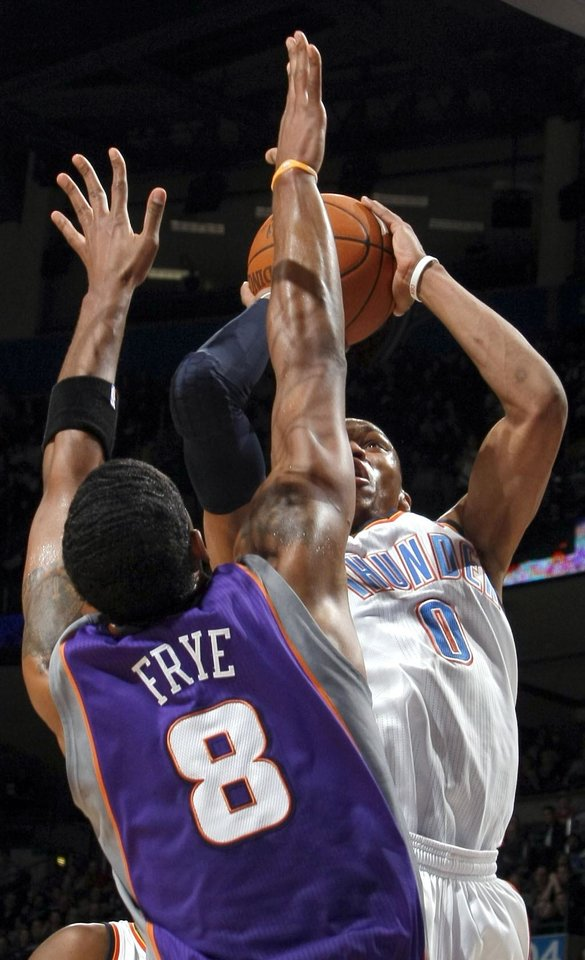 Oklahoma City's Russell Westbrook (0) shoots over Phoenix' s Channing Frye during the NBA basketball game between the Oklahoma City Thunder and the Phoenix Suns, Sunday, Dec. 19, 2010, at the Oklahoma City Arena. Photo by Sarah Phipps, The Oklahoman